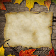 Autumn leaves over old wooden background — Stock Photo