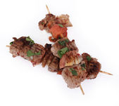 Tasty lamb skewers isolated on white — Stock Photo