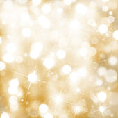 Christmas background with blur golden lights — Stock Photo
