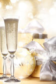 Champagne glasses on gold blur background — Stock Photo