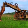 Old abandoned Excavator - Stock Photo
