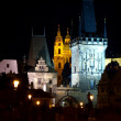 Old prague towers at nigh — Stock Photo