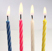 Birthday candles on white background — Stock Photo