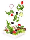 Légumes frais en mouvement sur blanc — Photo