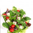 Greek salad over white - Stock Photo