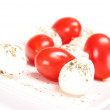 Fresh mozzarella cheese with tomatoes — Stock Photo