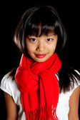 Cute girl in a red scarf — Stock Photo