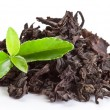 Heap of dry tea with green tea leaves. - Stock Photo
