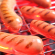 Hot sausages on barbecue — Stock Photo