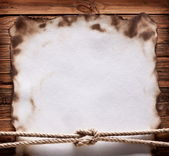 Image of old paper on wood background. — Stock Photo