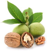 Green walnut; peeled walnut and its kernels. — Stock Photo