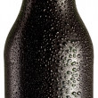 Bottle of black beer with drops on white background. — Photo