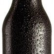 Stock Photo: Bottle of black beer with drops on white background.