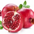 Ripe pomegranates with leaves. — Stock Photo