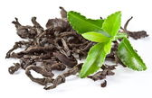 Heap of dry tea with green tea leaves. — Stock Photo