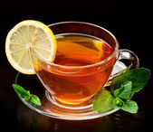 Cup tea with mint and lemon. — Stock Photo