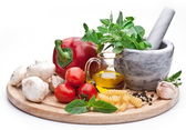 Mortar, herbs and vegetables. — Stock Photo