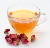 Cup of tea and tea roses. — Stock Photo