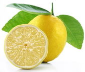 Lemon with slice on a white background — Stock Photo