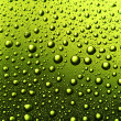 Texture of water drops on the bottle of beer. — Stock Photo
