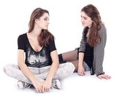 Two teen girlfriends on a white background. — Stock Photo
