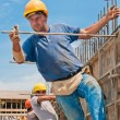 Construction workers installing formwork frames — Stock Photo #6747451