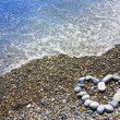 Heart on stone beach — Stock Photo