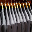 Stock Photo: Men suits in row
