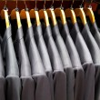 Men suits in row — Stock Photo #7888122