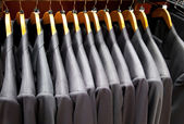 Men suits in row — Stock Photo