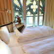 Hotel room with gothic window — Stock Photo