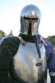 Knight in metal armour — Stock Photo
