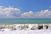 Big waves of surf on the sea coastline in summer — Stok fotoğraf