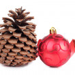 Foto Stock: Tree cones and red ball