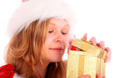 Miss Santa is Sneaking a Peek at a Golden Gift Box — Stock Photo