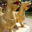 Big golden dragons in buddhist temple — Stock Photo