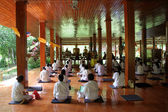 Meditation in wooden temple — Stock Photo