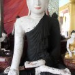 Wihite Buddha with dark robe - Lizenzfreies Foto