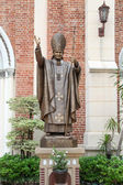 Statue near church — Stock Photo