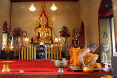 Golden Buddha and monk — Stock Photo