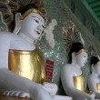 Long row of Buddhas — Stock Photo #7624633
