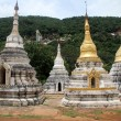 Stock Photo: Stupas and entrance