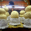 Golden eggs on buddhist shrine — Stock Photo