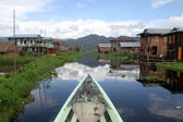 Boat and wooden houses — Stock Photo