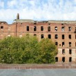 Ruins of red brick mill — Stock Photo