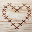 Stock Photo: Heart on wood