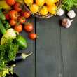 Royalty-Free Stock Photo: Design background vegetables on a wooden background