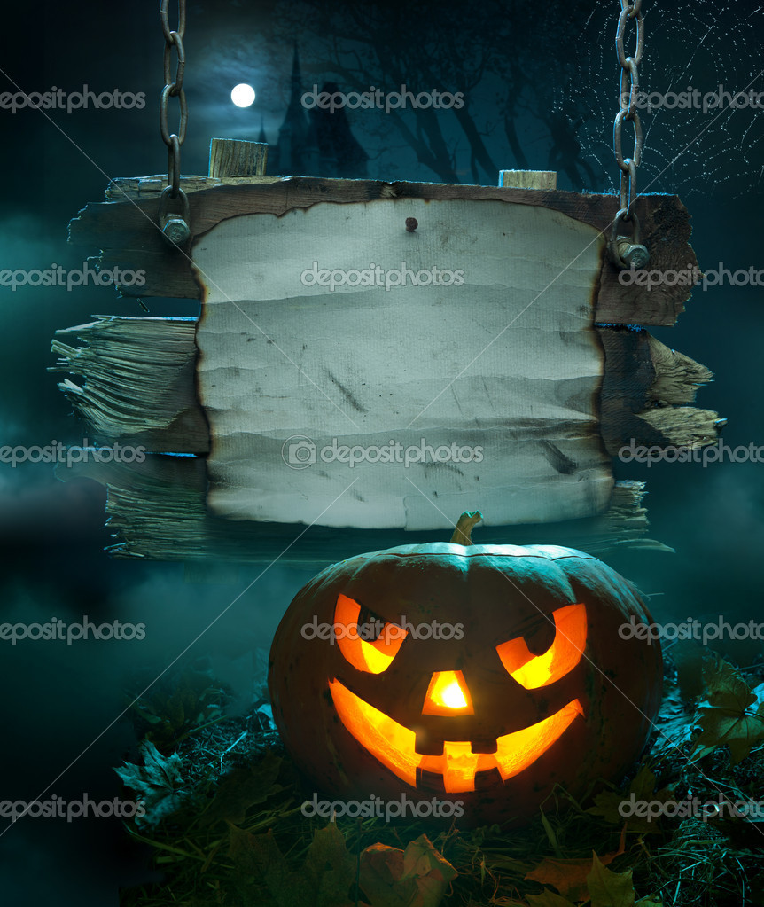 Halloween design, glowing pumpkin in a dark scary forest church  Zdjcie stockowe #7068276