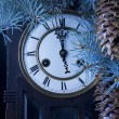 Midnight antique clock and a Christmas tree - Stock Photo