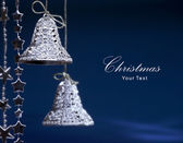 Art Christmas greeting card with Christmas bells on a blue background — Stock Photo